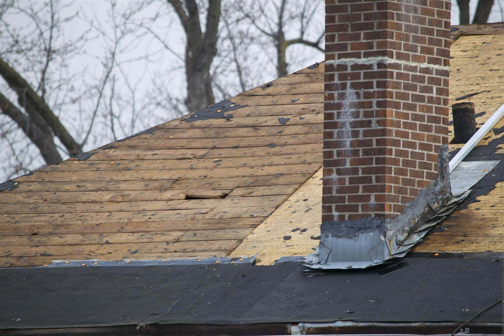 Damaged roofing from a Wisconsin wind storm