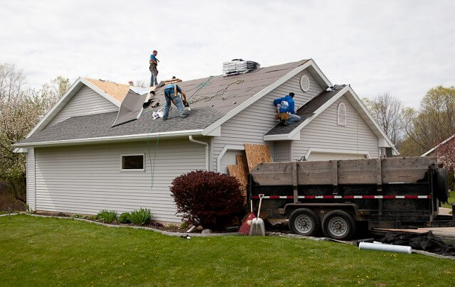 Roofing Contractors Working on a Green Bay home