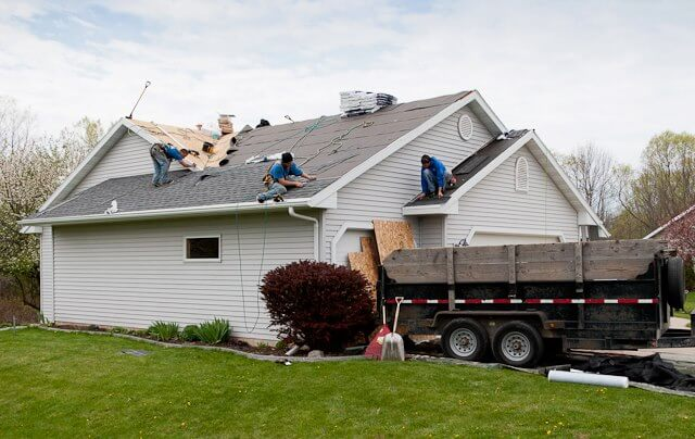 Roofing Contractors Finishing Up a job