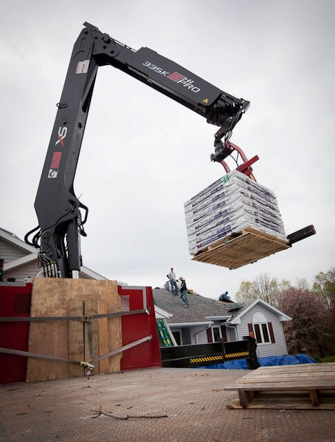 A pallet of shingles showing up at a Green Bay roofingjob